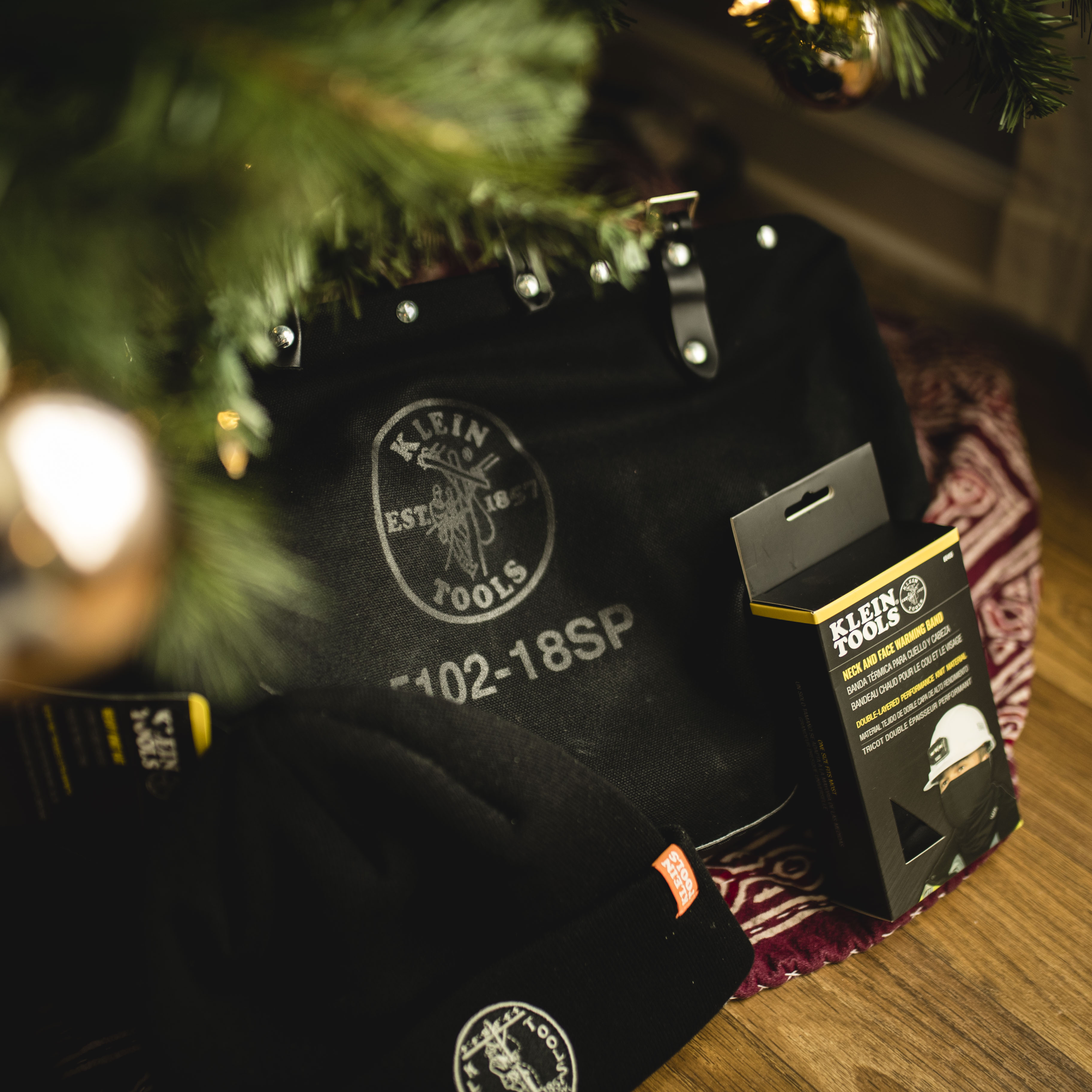 Black deluxe bag under a Christmas tree