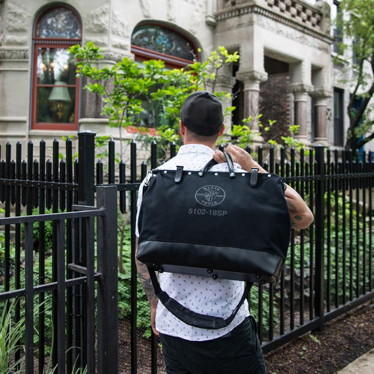 Man carrying black bag
