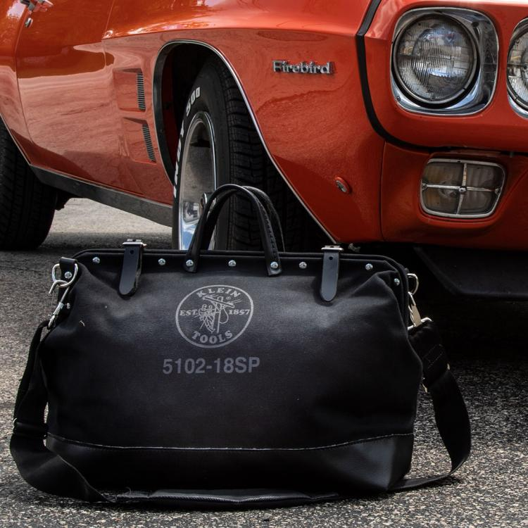 Black bag and orange Firebird